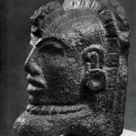 «Пальма» в виде головы человека. Культура тотонаков. Базальт. Мехико, Собрание Национального института антропологии