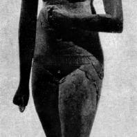 Обнаженная девушка. Деревянная статуэтка. XVIII династия. Конец 15 в. до н. э. Париж. Лувр