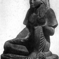 Статуя писца Хапи из Карнака. Красный песчаник. XIX династия. 13 в. до н. э. Каир. Музей