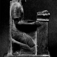 Коленопреклоненный мужчина с наосом. Середина XIV в. до н. э. Фивы. Вид сбоку